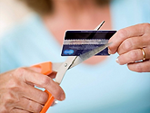 photo of woman cutting credit card