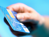 photo of hand holding credit card