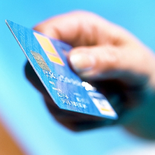 photo of hand holding a credit card