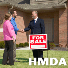 photo of homebuyers and realtor