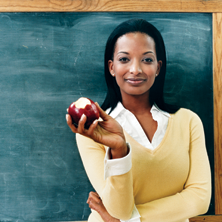 Photo of a teacher with an apple
