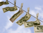 photo of bills on a clothesline
