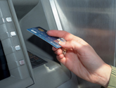 photo of hand holding a debit card