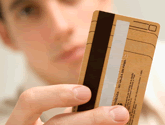 photo of man holding credit card