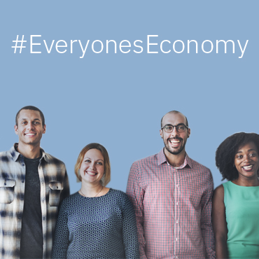 "photograph of a line of smiling people, with the tagline ""Everyone's Economy"""