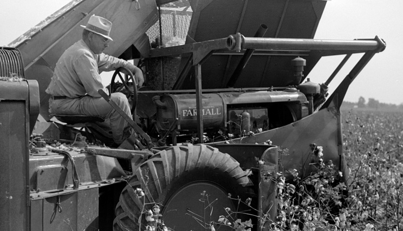 historical black-and-white photo of 1930s-era cotton farm equipment