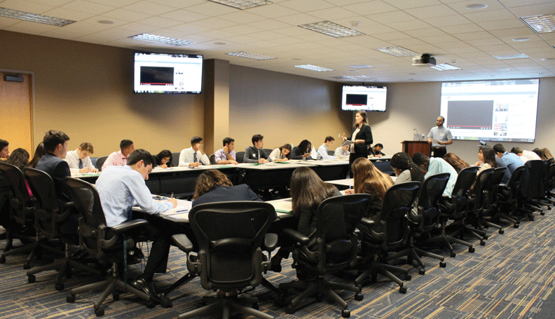 Students take notes at an employability workshop focusing on resume writing at the Atlanta Fed's Miami Branch.