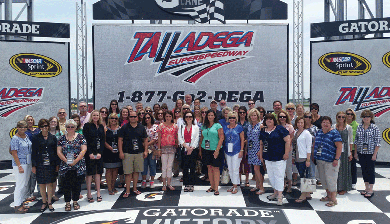 More than 50 teachers learn about tourism's impact on Alabama's economy during a workshop at the Talladega Superspeedway as part of the Atlanta Fed's