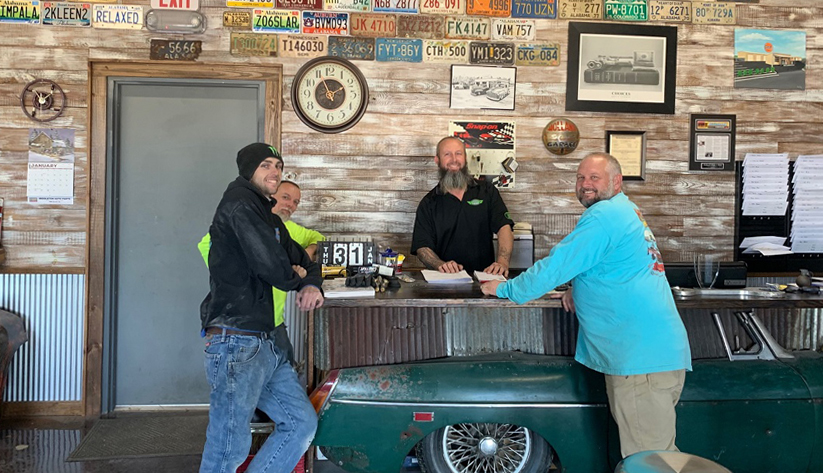 Owner Bobby Holland employs eight people at his auto body shop in Robertsdale, Alabama. His shop is decorated with some vintage touches. Photo courtesy of United Bank