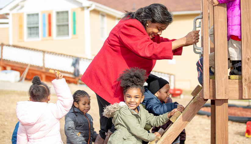 Co-owner Juanisa Kimbrough accompanies children during recreational activities at Ms. Niecy's Home Away from Home Learning Center. Photo courtesy of Access to Capital for Entrepreneurs