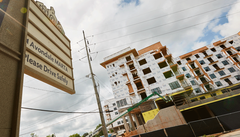 housing development under construction with a sign for the Avondale MARTA station in the foreground