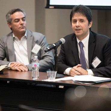 Marcelo Bernal of Merchant e-Solutions, left, and Nelson Mikovenyi of Delta Air Lines speak about business opportunities in Brazil. Photo by Fabio Laub