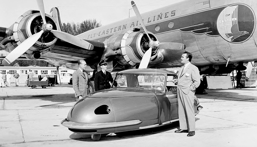 With an Eastern Air Lines plane in the background, a three-wheel automobile on the tarmac at Atlanta Municipal Airport, 1948. Photo courtesy the Special Collections and Archives, Georgia State University Library