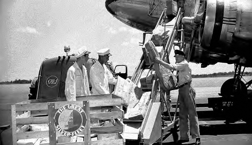 Loading baggage onto a plane in 1944 at Atlanta Municipal Airport. Photo courtesy the Special Collections and Archives, Georgia State University Library