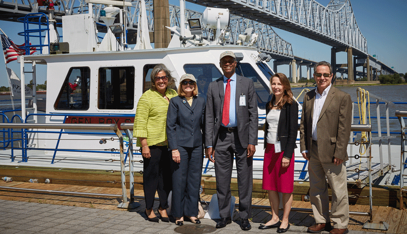 At the Port of New Orleans (left to right): Tara Carter Hernandez, president of JCH Properties and the commissioner of the Port of New Orleans; Gail Psilos, director of the Regional Economic Information Network at the Atlanta Fed's New Orleans Branch; Atlanta Fed President Raphael Bostic; New Orleans Branch Regional Executive Adrienne Slack; and Bobby Landry, commerce chief of the Port of New Orleans. Photo by David Fine