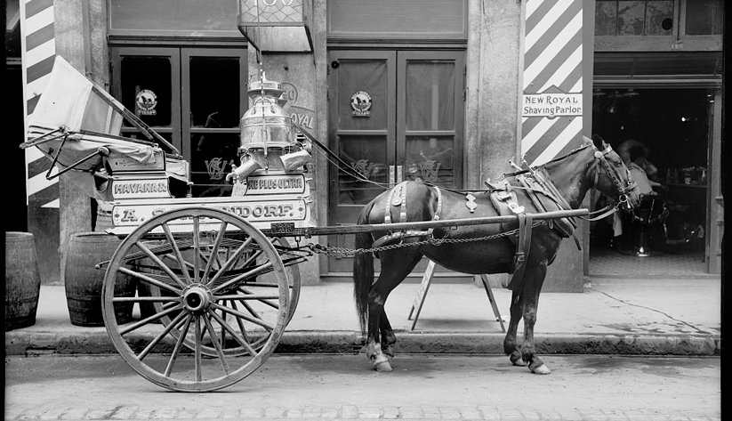 A milk cart in front of a barbershop in New Orleans, ca. 1900–10. Photo courtesy of the Library of Congress photographic archives