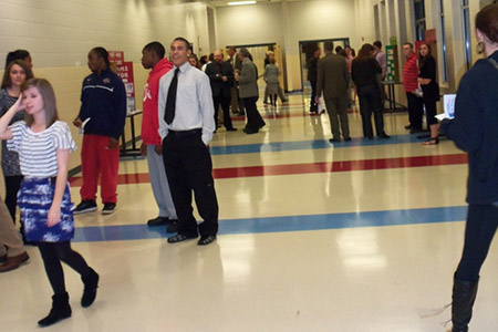 Attendees review the hall displays at the Oakland High School Personal Finance Fair.