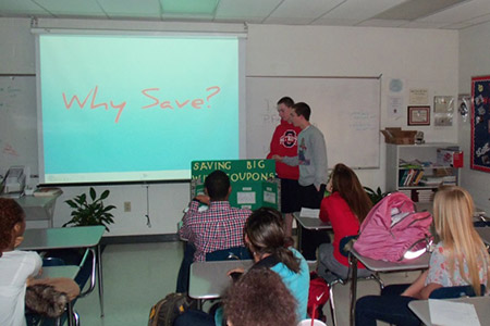 Oakland High School students practice their presentations in preparation for the Personal Finance Fair.