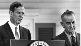 Associated Press photograph of Federal Reserve Chair William McChesney Martin and President Lyndon Johnson at a podium