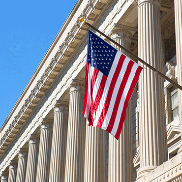 federal reserve board building facade with flag