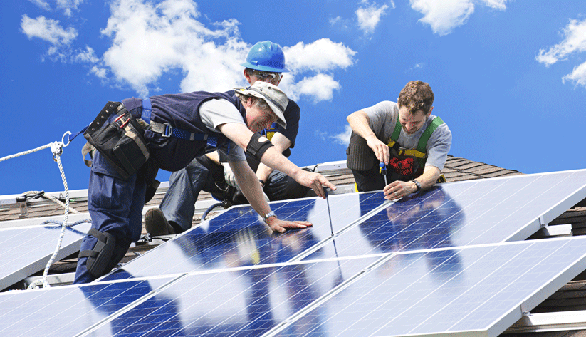 solar cells being set into place by a crew of 3 men
