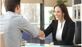 young woman in business suit shaking hands with a recruiter after getting a job offer