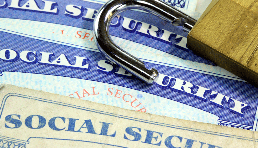 social security card topped by an open padlock