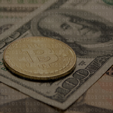 photograph of a bitcoin coin laid on top of a one-hundred dollar bill overlaid by binary digits