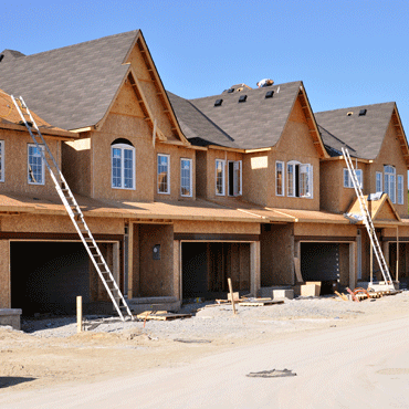 photograph of a row of townhomes under construction