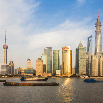 daytime photo of Shanghai skyline from the water