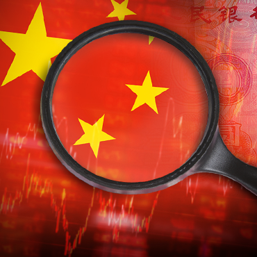 photo illustration of a magnifying glass over a Chinese flag