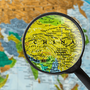 image of a map of Africa and Asia with a magnifying glass over China