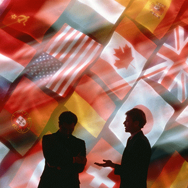 2 men silhouetted against national flags montage