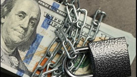 photograph of a 100-dollar bill bound with chains and a padlock