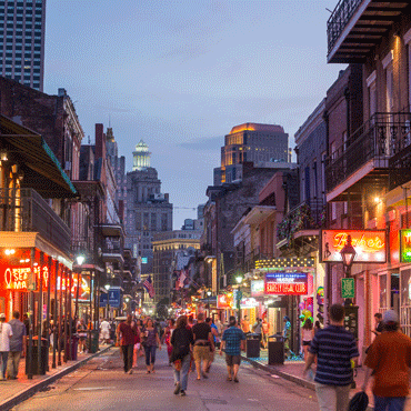 photo of New Orleans' Bourbon Street at nightfall