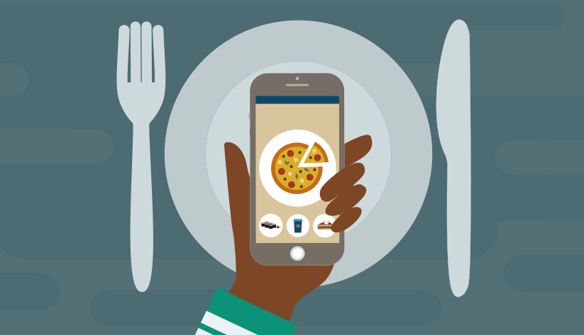 hand extended over place setting holding mobile with image of pizza