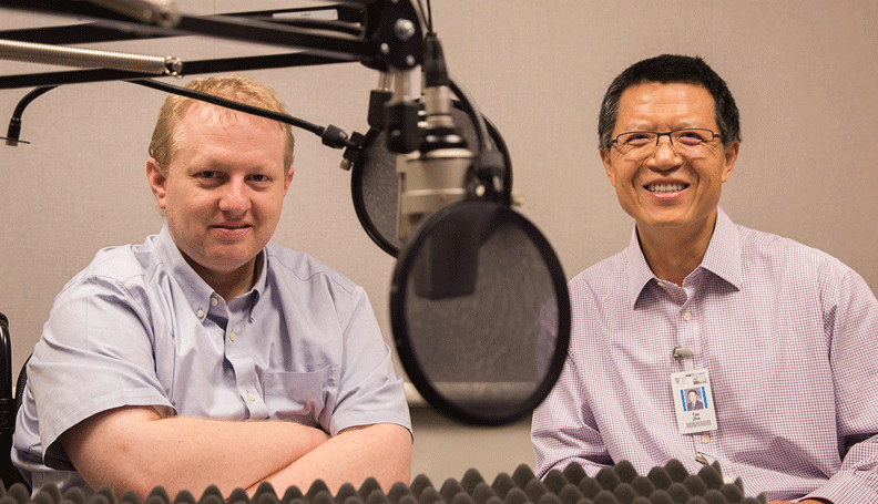 Pat Higgins, associate policy adviser and economist, and Tao Zha, research center executive director, at the recording of a podcast episode.