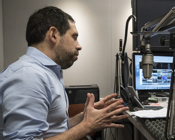 research economist and associate adviser Federico Mandelman at a podcast taping