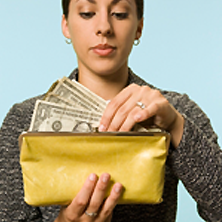 Photo of woman holding cash