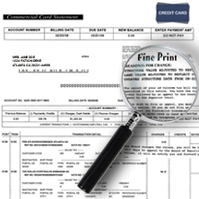 credit card statement and magnifying glass